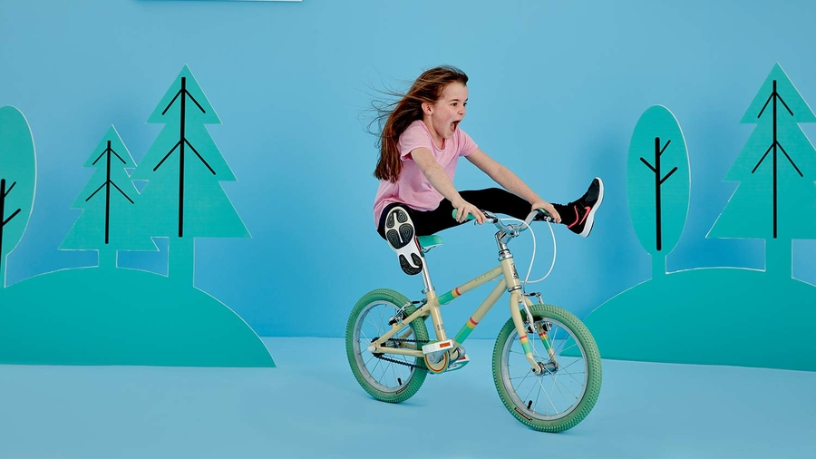A girl riding a Raleigh POP Kids bike