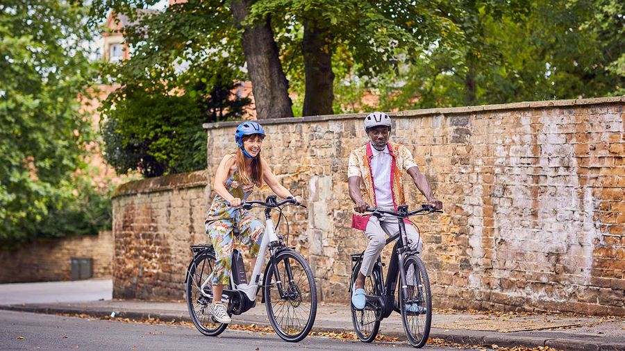 Couple cycling on ebikes uphill