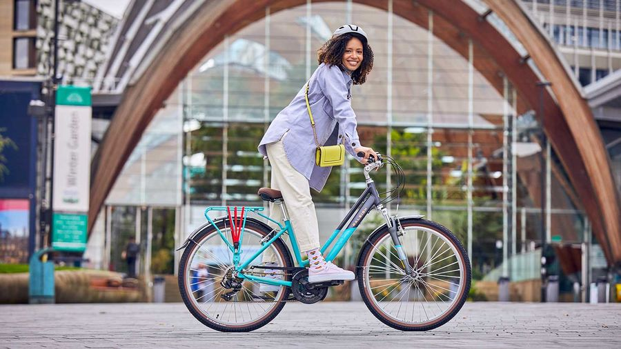 A Lady riding the Raleigh Pioneer in the city