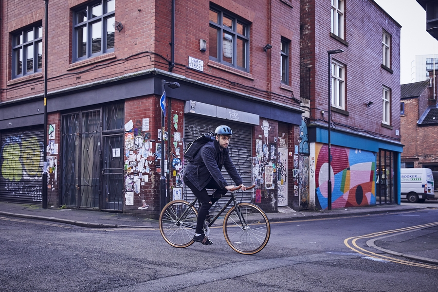 Man cycling to work on his Raleigh Bike