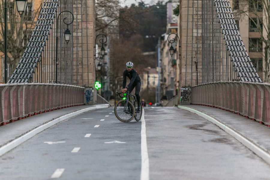 Man on a bridge riding the Lapierre Aircode DRS 8.0
