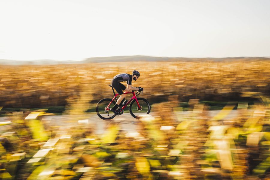 History page - image of a man racing on a Lapierre road bike through a field