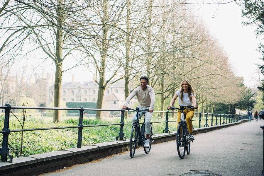 Man and woman biking together