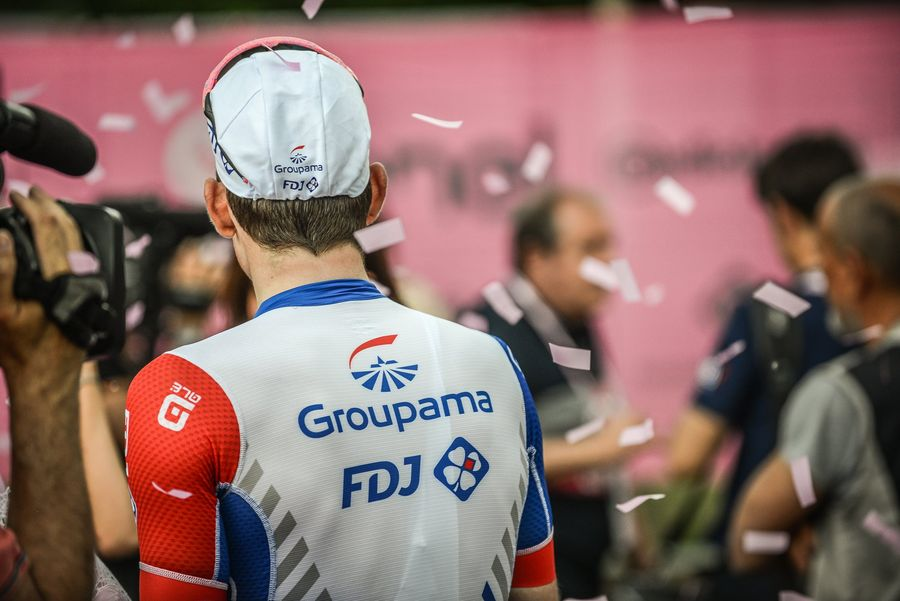 Groupama FDJ logo on the back of a cyclist