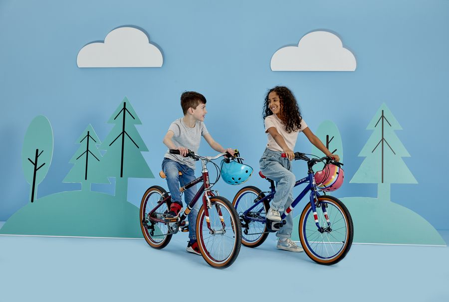 Two kids sitting on a Raleigh Kids Bike