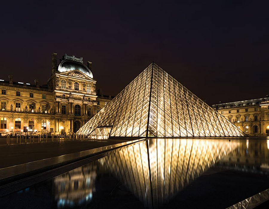 the louvre in paris lit up at night