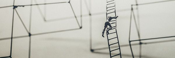 abstract man climbing a ladder