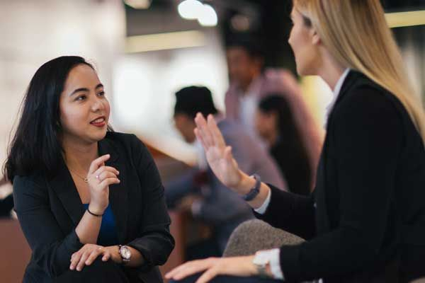 Business women networking at an event