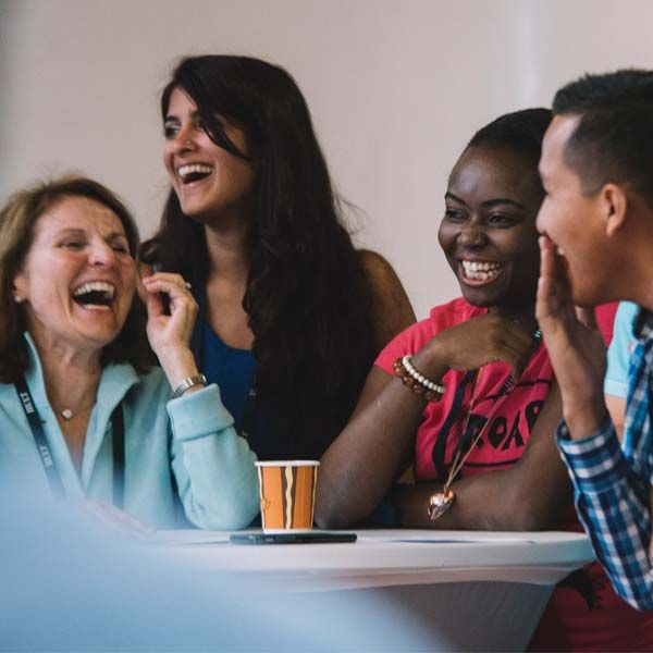 Business school students laughing | Hult