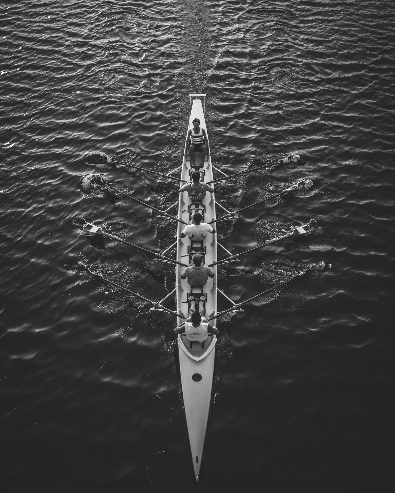 Rowing team rowing on a river