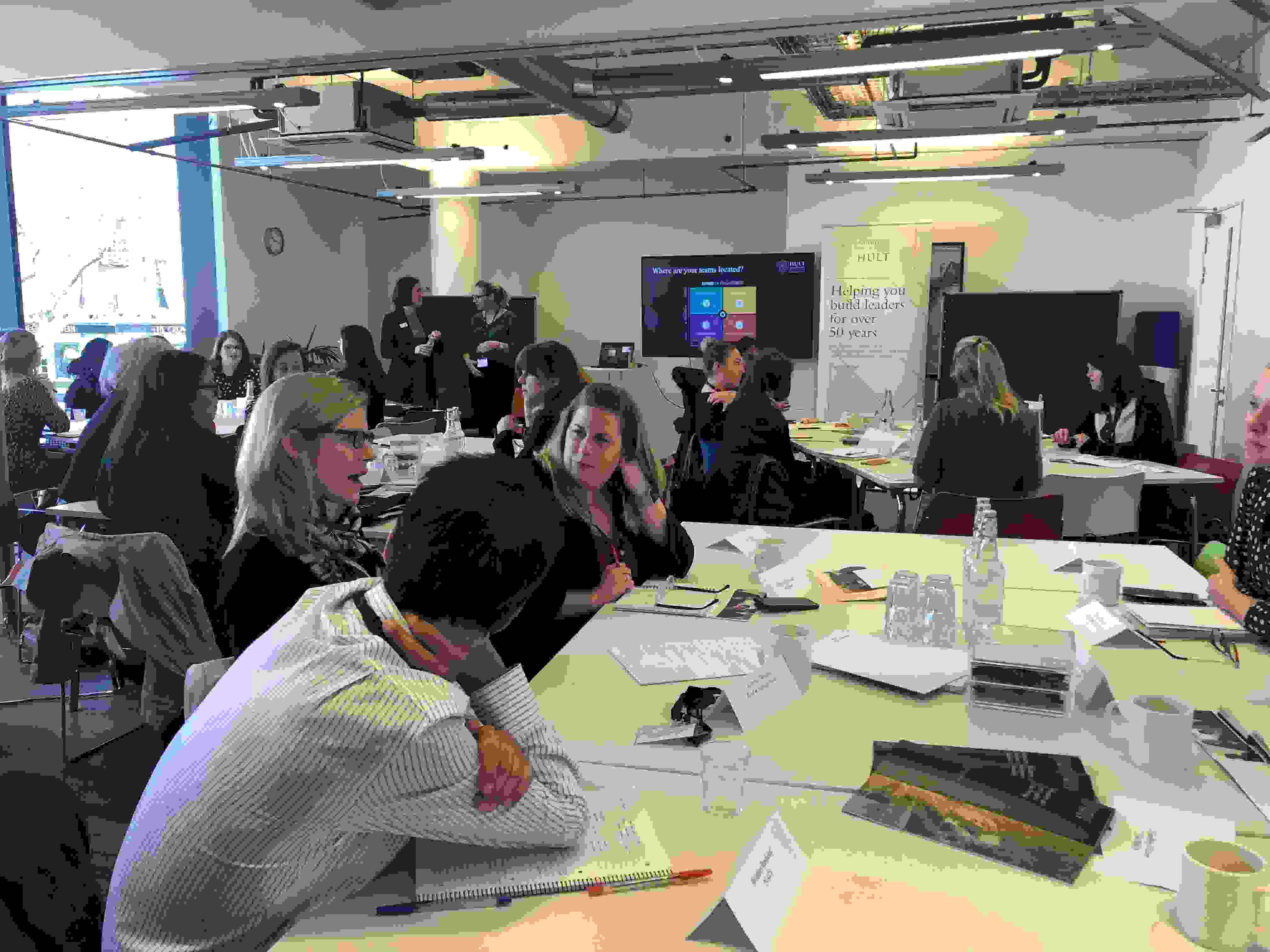 Busy conference room full of people