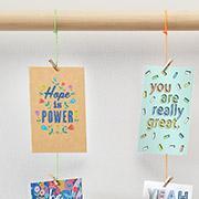 inspirational designed postcards hanging on a pole