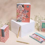 Floral notebooks with gold pens