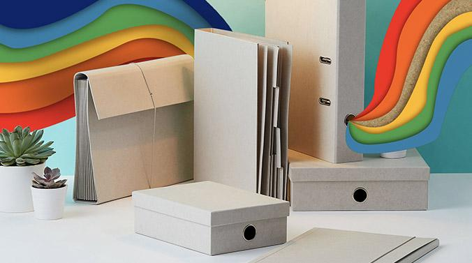Light grey Kraft storage collection featuring A4 expanding document file with elastic strap closure, A4 document wallet with dividers, A4 lever arch file, A4 stationery box and A5 stationery box with rainbow print running through the background.