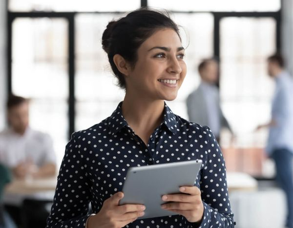 Woman holding a tablet smiling