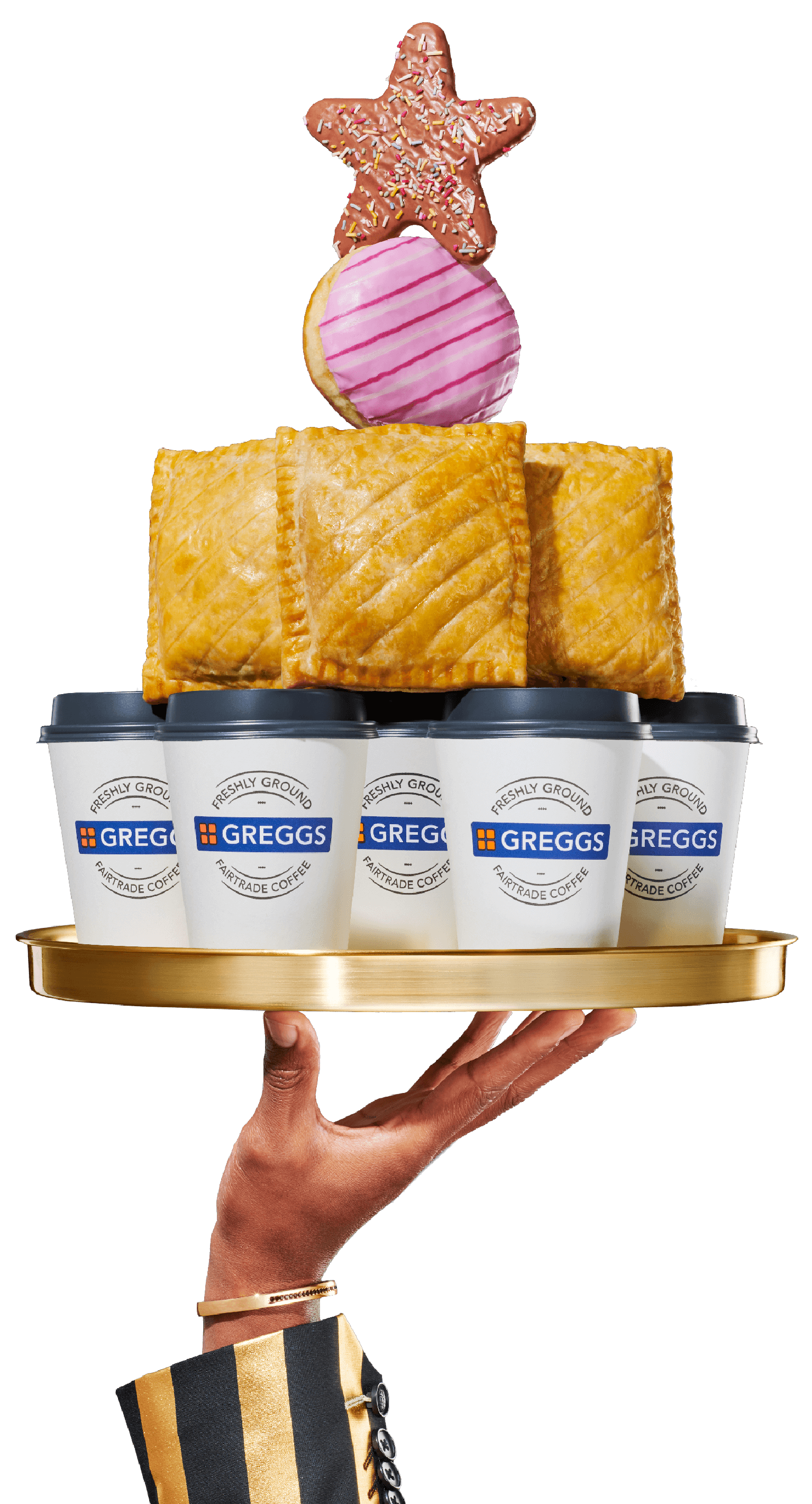 Hand holding tray stacked with Greggs hot drinks, savoury snacks and sweet treats
